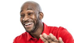 23826986-portrait-of-a-late-20s-handsome-black-man-laughing-isolated-on-white-background